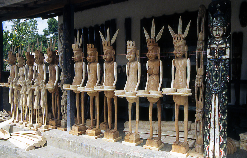 Bicycling Bali-Wooden figurines in Bali Indonesia