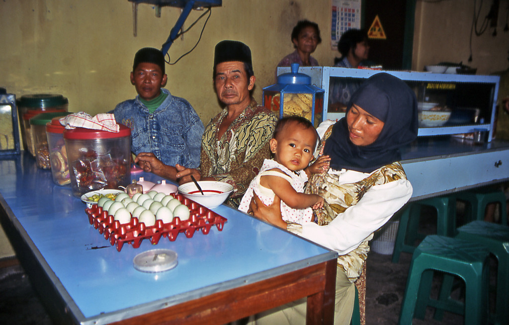 Bicycling Java Indonesia This Muslim family had a new baby to show off