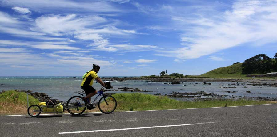 Bicycling North Island New Zealand-East Cape-Raukokori Anglican Church in the distance